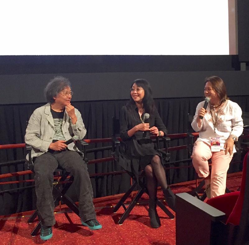 導演編劇組合張婉婷(中)及羅啟銳(左)七月二十三日(紐約時間)出席《三城記》的映後交流會。《三城記》是今屆亞洲美國國際電影節主打電影。