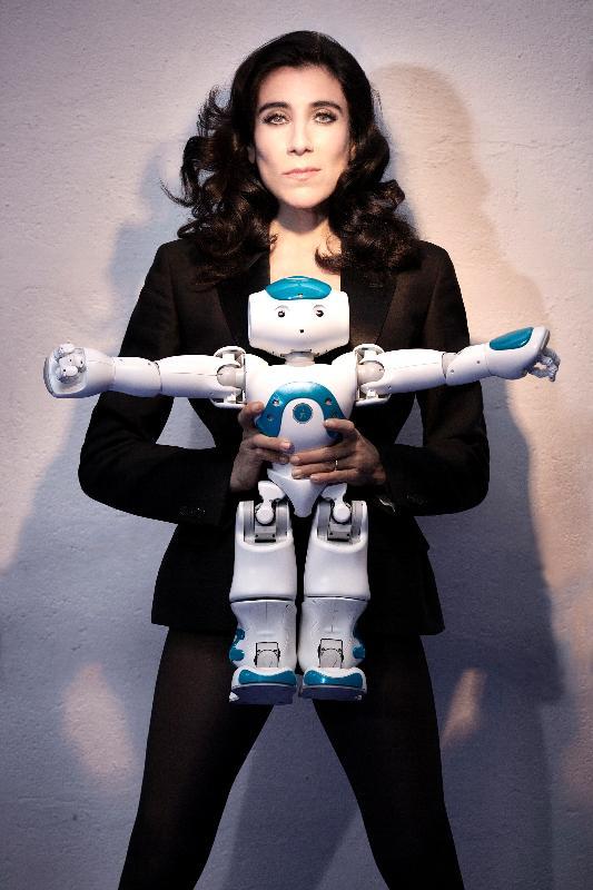 "Choreographer Blanca Li and a 2-foot-tall NAO robotic novice dancer from the dance extravaganza ""ROBOT""."
