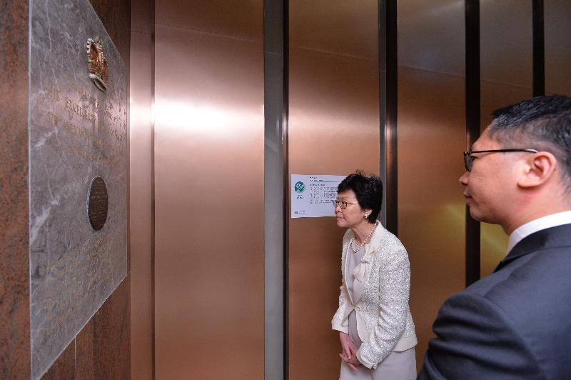 The Chief Secretary for Administration, Mrs Carrie Lam, visited the office building of the Department of Justice at Justice Place in Central this afternoon (August 4) and viewed a number of heritage items in Justice Place. Photo shows Mrs Lam viewing the commemorative plaque for the opening of the former Central Government Offices in 1957.