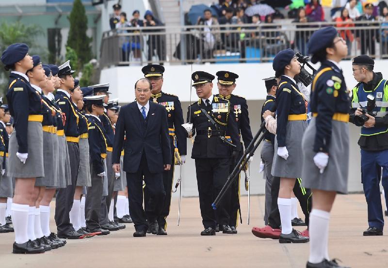 政務司司長張建宗(左一)今日(三月二十六日)於香港警察學院主禮香港交通安全隊周年大會操。