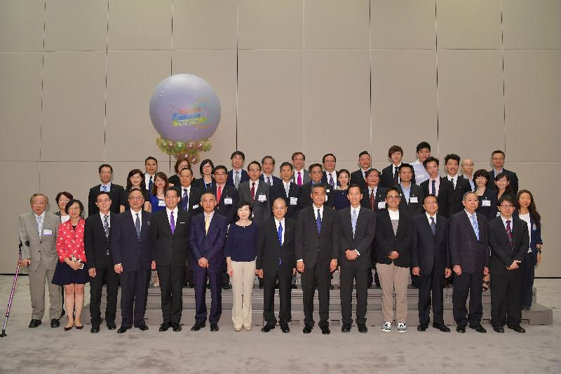 The Chief Executive, Mr C Y Leung, held a welcoming reception this evening (June 15) for speakers, exhibitors and supporting organisations taking part in the Gerontech and Innovation Expo cum Summit. Mr Leung (front row, sixth right); the Chief Secretary for Administration, Mr Matthew Cheung Kin-chung (front row, seventh right); the Chairperson of the Hong Kong Council of Social Service, Mr Bernard Chan (front row, fifth right); and the Chairperson of the Board of Directors of the Hong Kong Science and Technology Parks Corporation , Mrs Fanny Law (front row, seventh left) are pictured with the exhibitors.