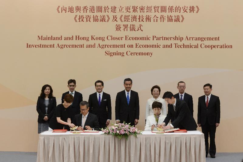 The Chief Executive, Mr C Y Leung, attended the Mainland and Hong Kong Closer Economic Partnership Arrangement Investment Agreement and Agreement on Economic and Technical Cooperation Signing Ceremony today (June 28). Photo shows (back row, from left) the Director-General of Trade and Industry, Ms Salina Yan; the Permanent Secretary for Commerce and Economic Development (Commerce, Industry and Tourism), Mr Philip Yung; the Secretary for Commerce and Economic Development, Mr Gregory So; Mr Leung; Deputy Director of the Liaison Office of the Central People's Government in the Hong Kong Special Administrative Region Ms Qiu Hong; the Director-General of the Department of Taiwan, Hong Kong and Macao Affairs of the Ministry of Commerce, Mr Sun Tong; and the Director-General of the Department of Exchange and Cooperation of the Hong Kong and Macao Affairs Office of the State Council, Mr Qian Yibing, witnessing the signing of the agreements by the Financial Secretary, Mr Paul Chan (front row, second left), and Vice-Minister of Commerce Ms Gao Yan (front row, second right).