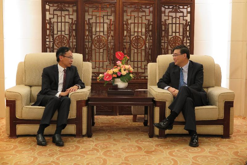 The Secretary for Constitutional and Mainland Affairs, Mr Patrick Nip (left), meets with the Director-General of the Department of Hong Kong, Macao and Taiwan Affairs of the Ministry of Foreign Affairs, Mr Feng Tie, in Beijing today (August 15).