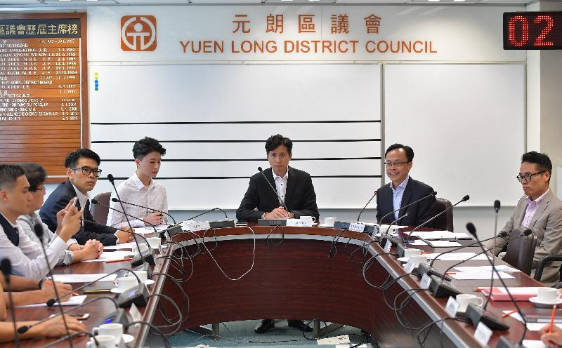 The Secretary for Constitutional and Mainland Affairs, Mr Patrick Nip, visited Yuen Long today (August 29) and met with members of the Yuen Long District Council (YLDC) to gain a better grasp of the district's developments and needs. Picture shows Mr Nip (second right) exchanging views with YLDC members in the company of the Chairman of the YLDC, Mr Shum Ho-kit (third right), and the District Officer (Yuen Long), Mr Edward Mak (first right).