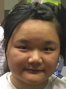 Lai Nga-man Maggie, aged 16, is about 1.55 metres tall, 68 kilograms in weight and of fat build. She has a round face with yellow complexion and long straight black hair. She was last seen wearing long-sleeved shirt with black and white stripes, black skirt, beige-coloured sandals and carrying a purple backpack.