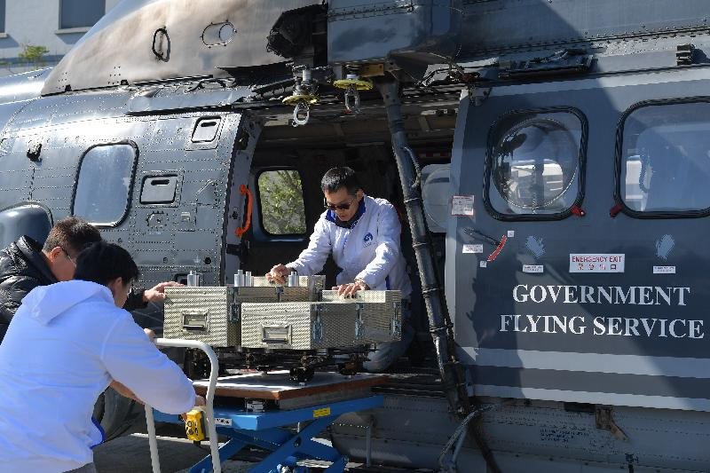 """The Government continued the inter-departmental exercise, """"Checkerboard II"""", this afternoon (December 20). Photo shows a Government Flying Service helicopter fitted with the Aerial Radiation Monitoring System (ARMS), which was deployed to join the exercise."""
