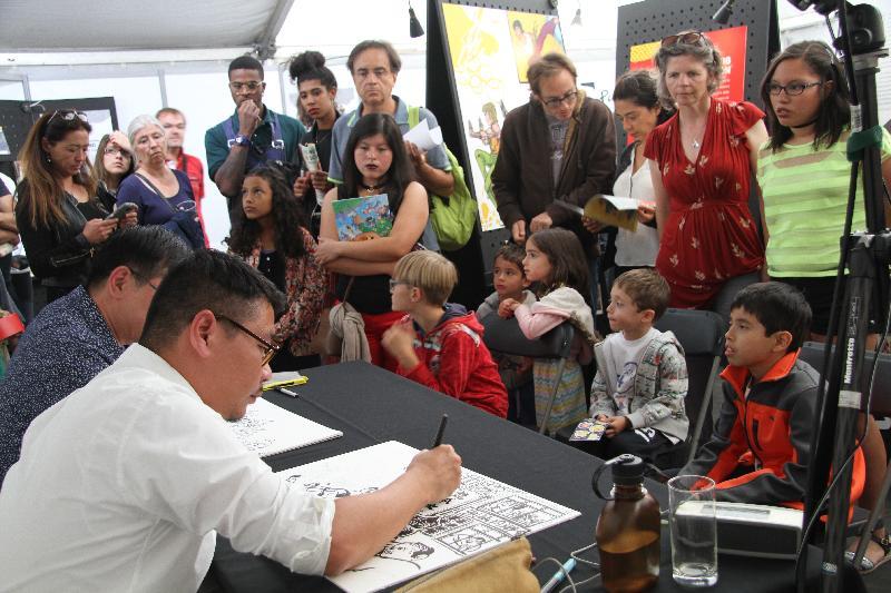 「PLAY! 香港漫畫巡迴展覽」一月十日至二月一日在灣仔動漫基地舉行。圖示早前在比利時布魯塞爾舉行展覽時的繪畫示範。