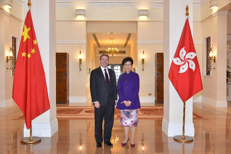 The Chief Executive, Mrs Carrie Lam (right), meets the Secretary of State for International Trade of the United Kingdom, Dr Liam Fox, at Government House today (March 21).