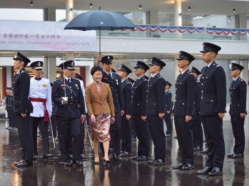行政長官林鄭月娥(左四)今日(五月九日)在消防及救護學院出席香港消防處150周年大會操。
