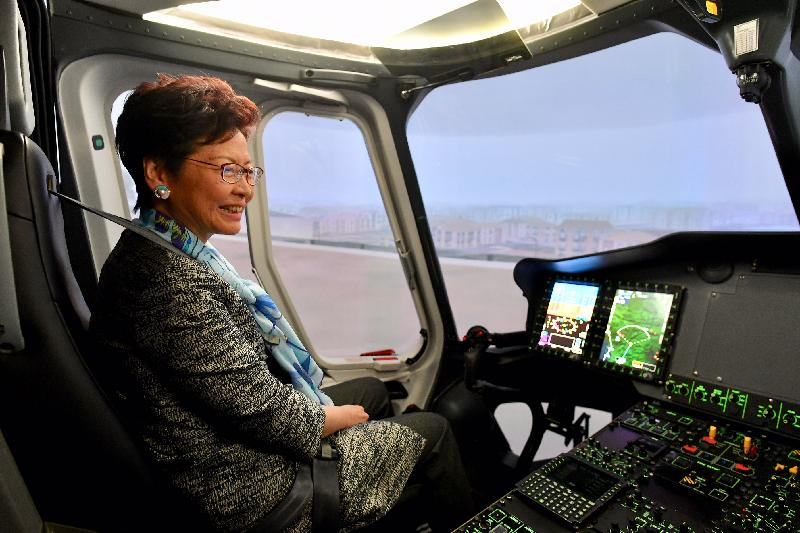 The Chief Executive, Mrs Carrie Lam, continued her visit to France in Marseille today (June 18, Marseille time). Photo shows Mrs Lam trying out flight simulation at Airbus Helicopters.