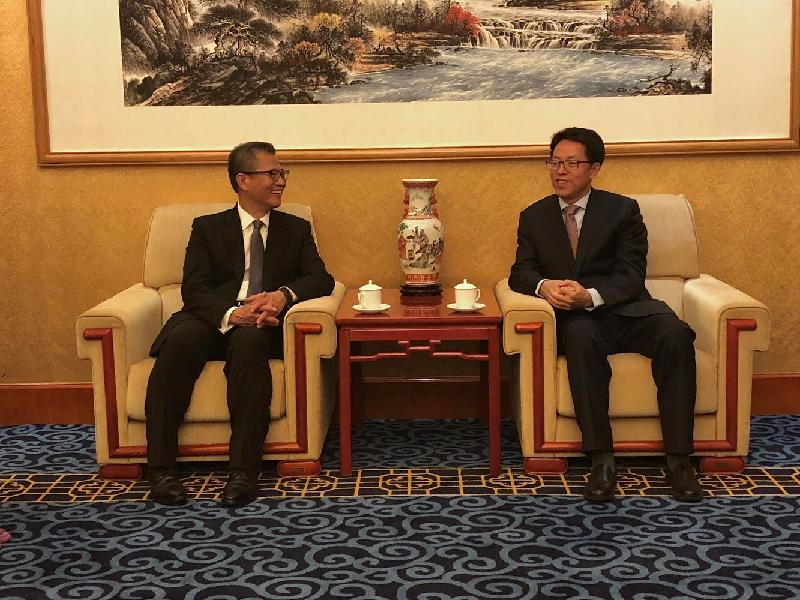 The Financial Secretary, Mr Paul Chan (left), today (June 20) calls on the Director of the Hong Kong and Macao Affairs Office of the State Council, Mr Zhang Xiaoming, in Beijing. Both parties exchanged views on issues of mutual interest.