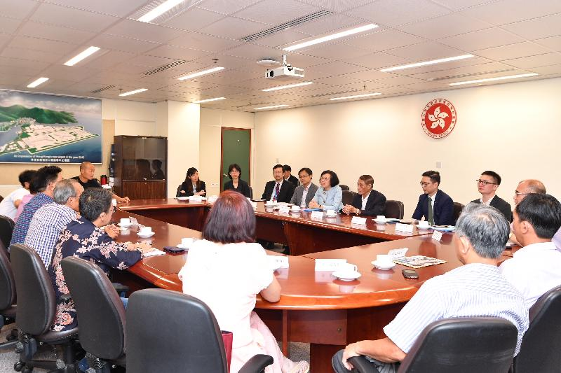 The Secretary for Food and Health, Professor Sophia Chan, visited Tung Chung today (June 21). Professor Chan (fourth right) is pictured meeting with Islands District Council members to listen to their views on various healthcare and environmental hygiene issues in the district. Looking on is the Chairman of the Islands District Council, Mr Chow Yuk-tong (third right), and the District Officer (Islands), Mr Anthony Li (fifth right).