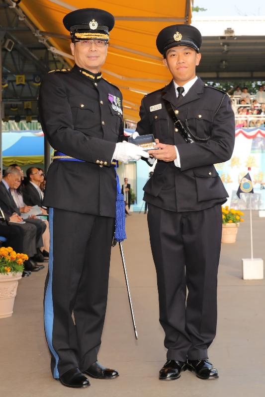 The Commissioner of Correctional Services, Mr Lam Kwok-leung (left), presents a Best Recruit Award, the Golden Whistle, to Assistant Officer II Mr Wong Man-nok at the Passing-out cum Commissioner's Farewell Parade of the Correctional Services Department at its Staff Training Institute in Stanley today (November 23).