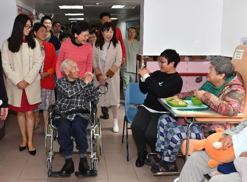 The Chief Executive, Mrs Carrie Lam (third left), visits elderly residents in a home for the elderly in Tsz Wan Shan this morning (February 5).