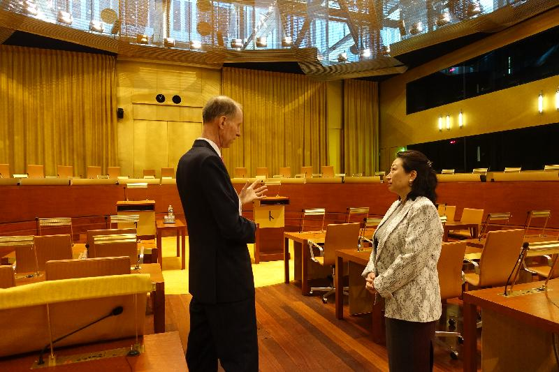 The Secretary for Justice, Ms Teresa Cheng, SC (right), accompanied by Judge Christopher Vajda (left), tours the Main Courtroom of the European Union Court of Justice in Luxembourg today (April 12, Luxembourg time).