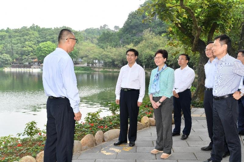 The Chief Executive, Mrs Carrie Lam, visited Zhaoqing, Guangdong today (May 17). Photo shows Mrs Lam (third left), accompanied by the Secretary of the CPC Zhaoqing Municipal Committee, Mr Lai Zehua (second left); the Mayor of the Zhaoqing Municipal Government, Mr Fan Zhongjie (fourth left); the Secretary for Constitutional and Mainland Affairs, Mr Patrick Nip (second right); and the Director General of the Hong Kong and Macao Affairs Office of the People's Government of Guangdong Province, Mr Liao Jingshan  (first right), visit the Xinghu Lake Wetland Park to learn about the progress of its water and heritage conservation projects.