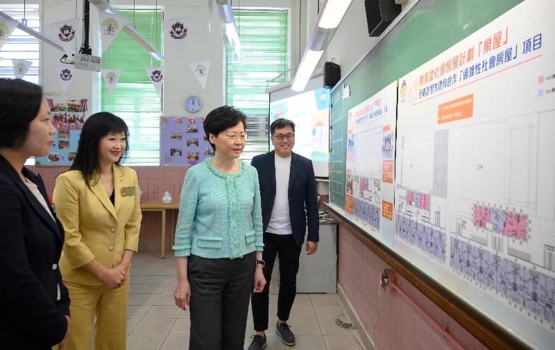 The Chief Executive, Mrs Carrie Lam, accompanied by the Secretary for Transport and Housing, Mr Frank Chan Fan, visited a transitional housing project operated by Lok Sin Tong today (August 9). Photo shows Mrs Lam (second right) and the Chairlady of the Lok Sin Tong Benevolent Society, Kowloon, Dr Yang Xiaoling (second left), being briefed by the Chief Executive of the Lok Sin Tong Benevolent Society, Kowloon, Ms Alice Lau (first left), at Lok Sin Tong Primary School on the project to convert the school into transitional housing.