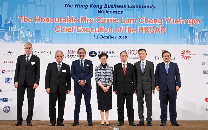 The Chief Executive, Mrs Carrie Lam, attended the Joint Business Community Luncheon at the Hong Kong Convention and Exhibition Centre today (October 31). Photo shows (from left) the Vice-Chairman of the Belgium-Luxembourg Chamber of Commerce in Hong Kong, Mr Philippe Latour; the President of the Chinese Manufacturers' Association of Hong Kong, Dr Dennis Ng; the Chairman of the Hong Kong General Chamber of Commerce, Dr Aron Harilela; Mrs Lam; the Chairman of the Chinese General Chamber of Commerce, Hong Kong, Dr Jonathan Choi; the Chairman of the Federation of Hong Kong Industries, Dr Daniel Yip; and the Chairman of the Hong Kong Chinese Enterprises Association, Mr Gao Yingxin, at the event.