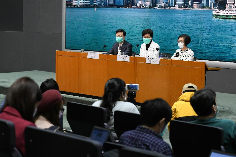 The Chief Executive, Mrs Carrie Lam (centre), holds a press conference on measures to fight the epidemic with the Secretary for Security, Mr John Lee (left), and the Secretary for Food and Health, Professor Sophia Chan (right), at the Central Government Offices, Tamar, today (March 23).