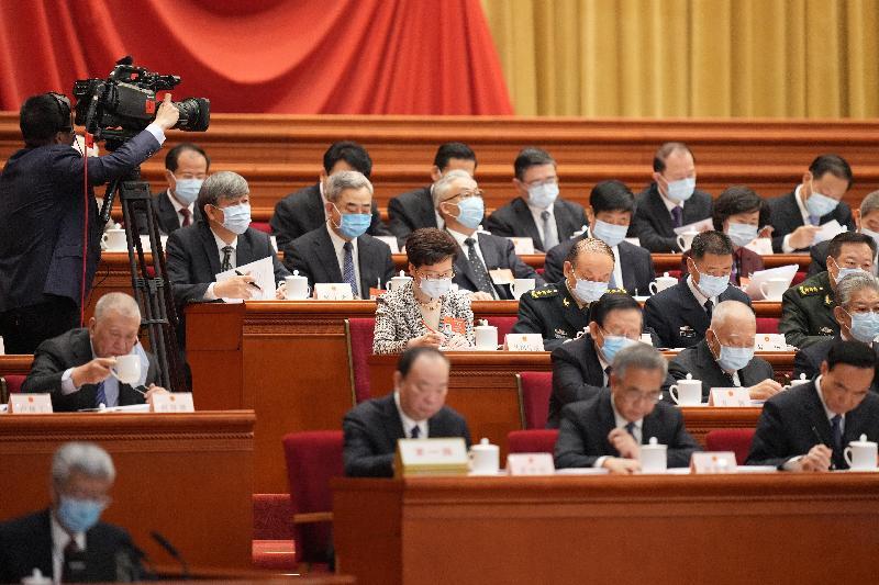 行政長官林鄭月娥(第三排右四)今日(三月五日)上午在北京列席第十三屆全國人民代表大會第四次會議開幕式。